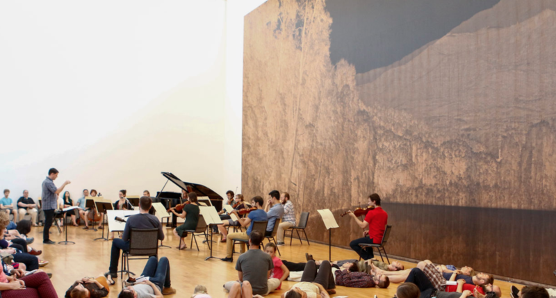"Nick Photinos conducts an ensemble in MASS MoCA's ""tall gallery"""